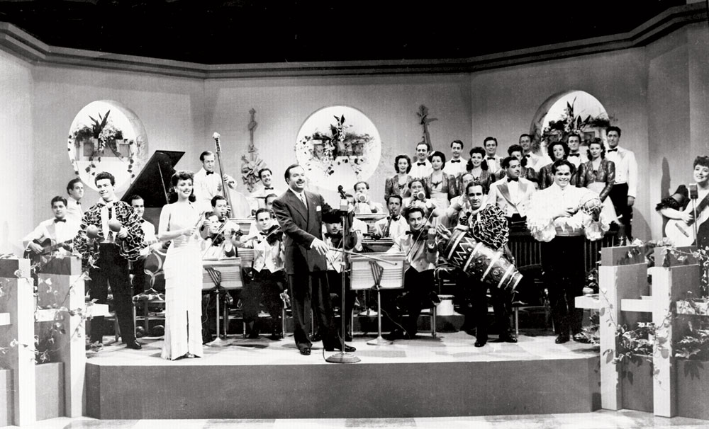 Xavier Cugat and his Orchestra, with Miguelito Valdés. Movie still from You Were Never Lovelier, Columbia Pictures, 1942. © SONY Pictures Entertainment. Raíces Latin Music Museum, New York City. Promised Gift of Louis Bauzó.